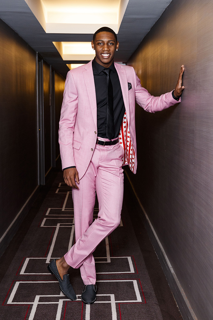 """Growing up, former Duke basketball star RJ Barrett envisioned his NBA draft day — particularly walking across the stage and greeting the league commissioner, Adam Silver. """"Shaking the commissioner's hand has always been a big thing for me,"""" Barrett, 19, tells The Post. """"When you're young and you watch the draft every year, you're like, 'That's going to be me one day.'"""" But until recently, the Toronto native hadn't thought about what he would wear for the most important handshake of his young life. Over the past few weeks, he's worked quickly to figure out his approach for Thursday night's draft, which is being held at the Barclays Center. Like his college hoops career, he wanted it to be splashy, sharp and a """"one and done"""" — the industry term for players who attend college for a single year before becoming NBA eligible. """"The suit is going to be put in plastic and preserved [after the draft]. Maybe I will go into my closet and look at it a bit. Maybe I'll frame it. Or at least the jacket,"""" explains the lean, 6-foot-7 small forward, who is expected to be a Top 3 pick. Barrett, who describes his everyday style as """"sweats,"""" will be sporting a bold pink suit with a black dress shirt, a black tie, gray Louboutin loafers trimmed with studs that retail for $995 and his brand-new Cartier watch. """"It's extravagant. I've always been a reserved kind of person, so the thought was, 'I want this to be memorable.' It's a night that I will never forget, so I want my suit to replicate that."""" **NO NEW YORK DAILY NEWS, NO NEW YORK TIMES, NO NEWSDAY**. 18 Jun 2019 Pictured: RJ Barrett tries on his custom Indochino pink suit that he is wearing to the NBA draft. Photo credit: Annie Wermiel/NY Post / MEGA TheMegaAgency.com +1 888 505 6342 (Mega Agency TagID: MEGA448920_015.jpg) [Photo via Mega Agency]"""