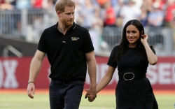 Britain's Prince Harry, left, and Meghan,