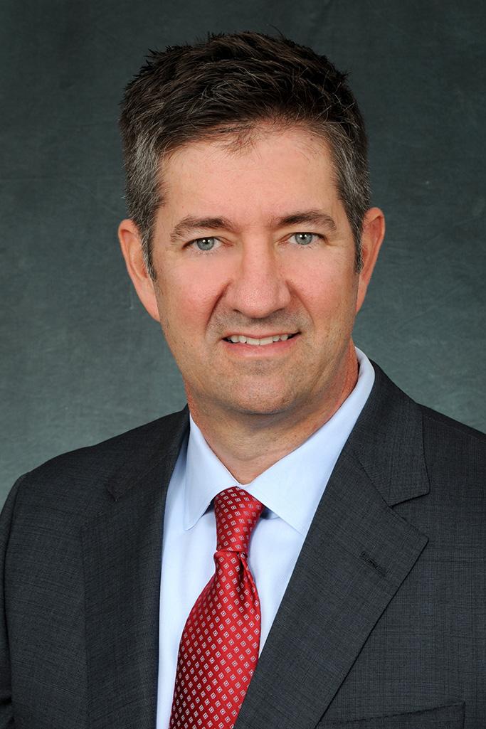 Genesco CFO Mel Tucker.
