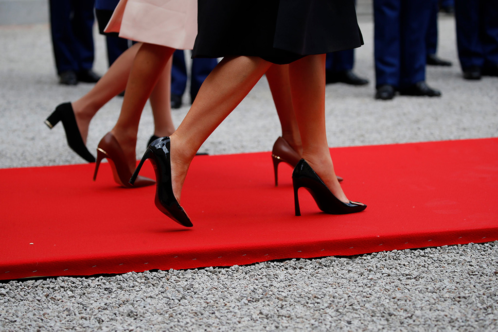 black roger vivier pumps, First lady Melania Trump, front, Brigitte Macron, center, and an unidentified staff member, far side, walk a red carpet, in Caen, FranceD-Day 75 Years, Caen, France - 06 Jun 2019
