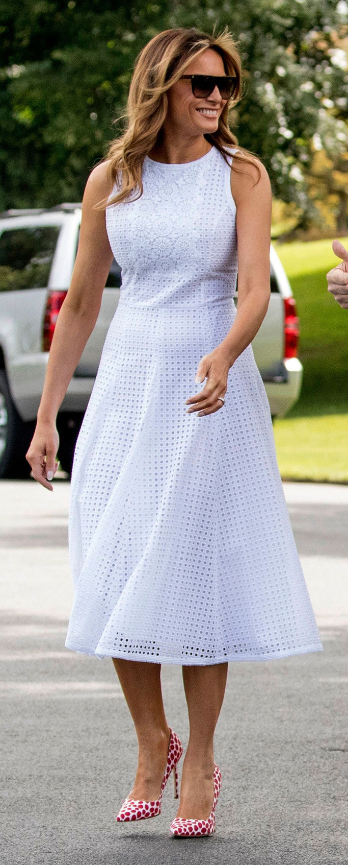 white Andrew GN eyelet dress, manolo blahnik bb pumps white with red spots, Donald Trump, Melania Trump. President Donald Trump and first lady Melania Trump walk towards members of the media before boarding Marine One on the South Lawn of the White House in Washington, for a short trip to Andrews Air Force Base, Md., and then on to Orlando, Fla. for a rallyElection 2020 Trump, Washington, USA - 18 Jun 2019