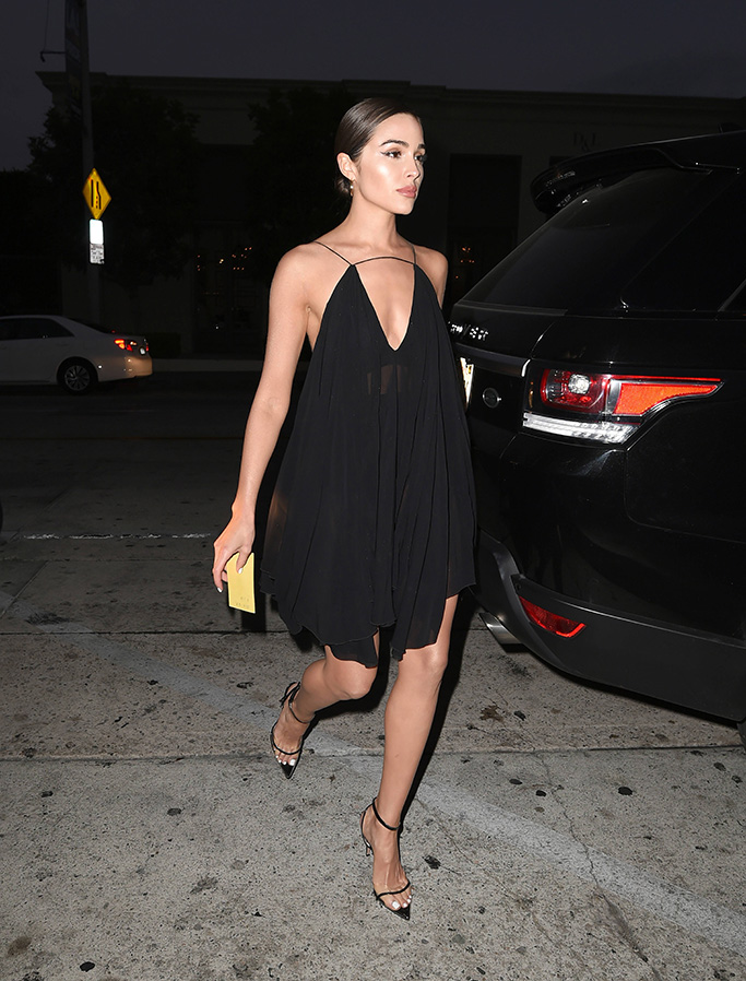 Olivia Culpo, black minidress, cleavage, night out look, see-through pumps, clear shoe trend, lbd, celebrity style, hoop earrings, steps out looking flawless in sheer skimpy black dress as she arrives to celeb hotspot Catch for dinner. 07 Jun 2019 Pictured: Olivia Culpo. Photo credit: MEGA TheMegaAgency.com +1 888 505 6342 (Mega Agency TagID: MEGA439507_016.jpg) [Photo via Mega Agency]
