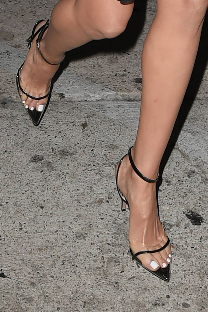 Olivia Culpo, feet, pedicure, celebrity shoe style, see-through pumps, legs,