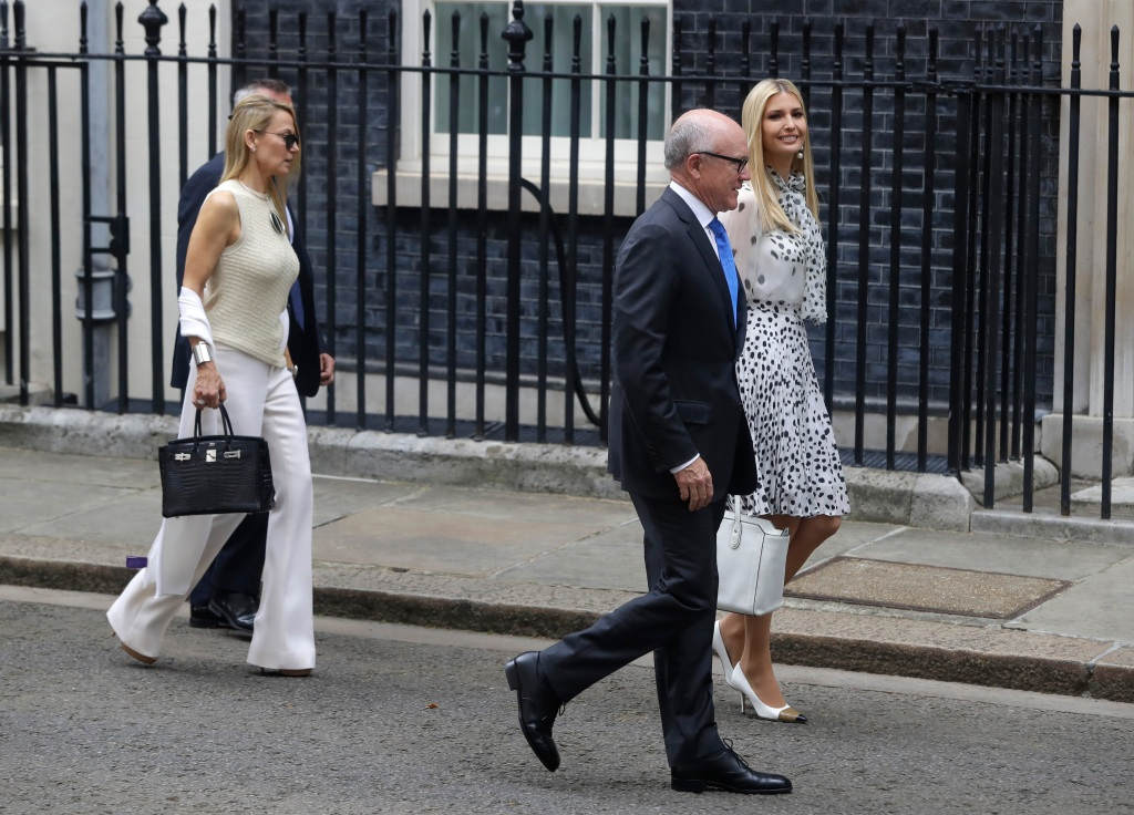 Ivanka Trump, right, and U.S. Ambassador to Britain Woody Johnson, second right, walk toward 10 Downing Street in central London, . President Donald Trump will turn from pageantry to policy Tuesday as he joins British Prime Minister Theresa May for a day of talks likely to highlight fresh uncertainty in the allies' storied relationshipTrump, London, United Kingdom - 04 Jun 2019