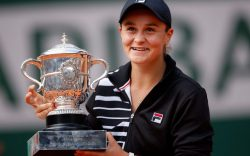 Ashleigh Barty of Australia lifts the
