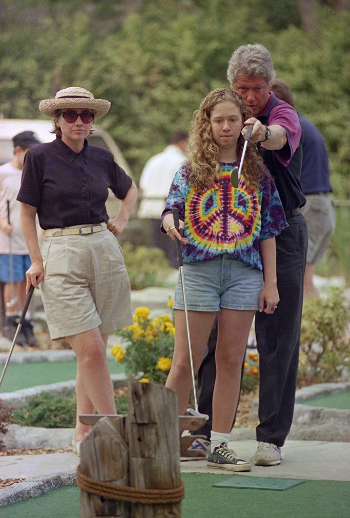 Golfing; leisure; recreation President Bill Clinton gives his daughter Chelsea miniature golfing tips on the second hole at the Island Cove Mini Golf course as Hillary Clinton looks on at left in Vineyard Haven, Massachusetts, on Martha's Vineyard. The Clintons are winding down on an 11-day vacationBill Clinton, Vineyard Haven, USA