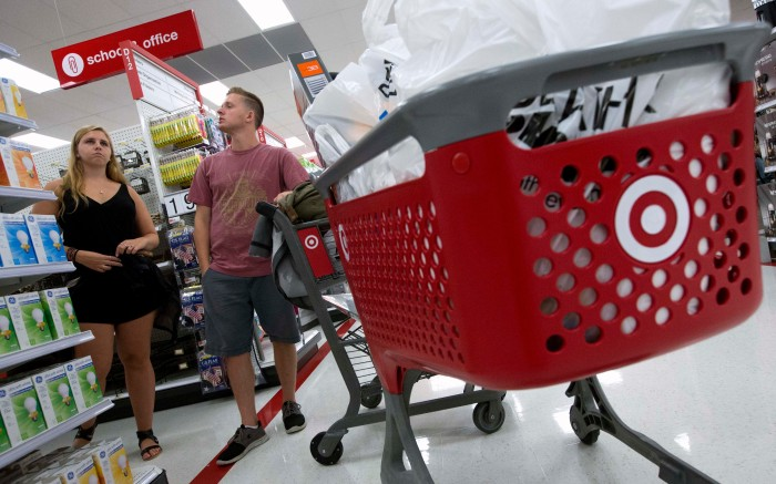 Boston College students Alli Urbon, left, and Eddie Dols, shop for back-to-school supplies at the CityTarget store in BostonBack to School Shopping Target, Boston, USA