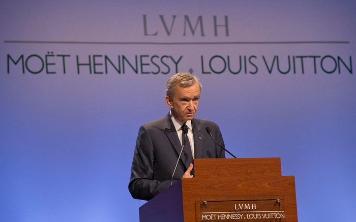"Bernard Arnault, Chairman and CEO of LVMH, ""Louis Vuitton Moet Hennessy"", the Paris-based luxury goods empire, poses prior to the presentation of the 2014 year results in Paris, France, . The fashion conglomerate behind Louis Vuitton, Dior and Hennessy says its net profit soared to 5.65 billion euros ($6.5 billion) last year, up 64 percent from 3.4 billion euros in 2013 and made sales of 30.6 billion euros in 2014France Earns LVMH, Paris, France"