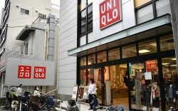 Customers walk out of a Uniqlo