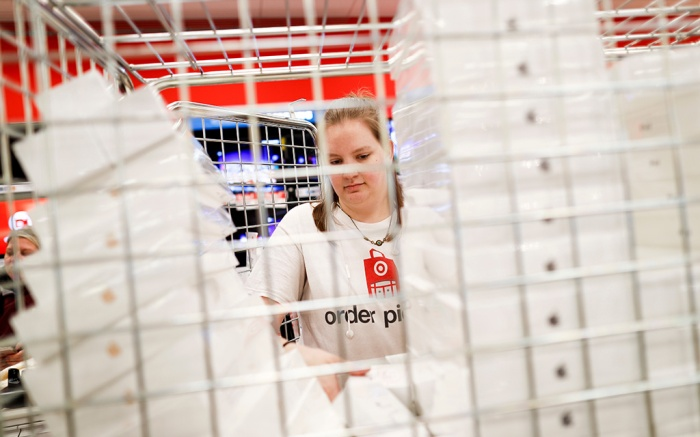 An employee unloads a mobile cage of Apple products during a Black Friday sale at a Target store, in Newport, KyHoliday Shopping, Newport, USA - 23 Nov 2018
