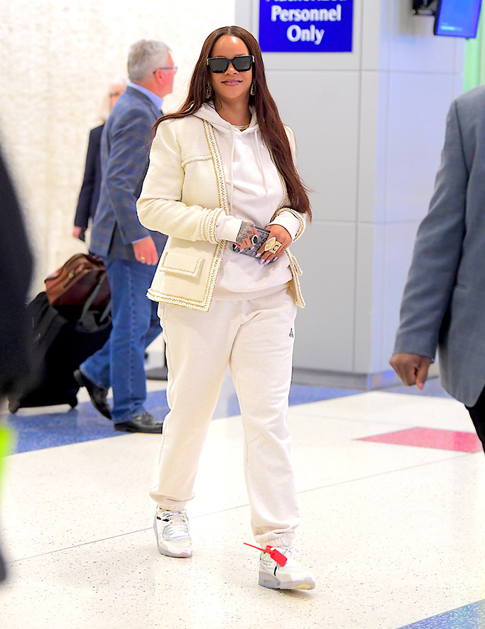Rihanna, airport style, Rihanna, Touches Down in NYC in All White as she Shows off her Golden Tan after Getaway in Italy with Boyfriend Hassan JameelPictured: RihannaRef: SPL5096658 080619 NON-EXCLUSIVEPicture by: DIGGZY / SplashNews.comSplash News and PicturesLos Angeles: 310-821-2666New York: 212-619-2666London: 0207 644 7656Milan: 02 4399 8577photodesk@splashnews.comWorld Rights, No Portugal Rights