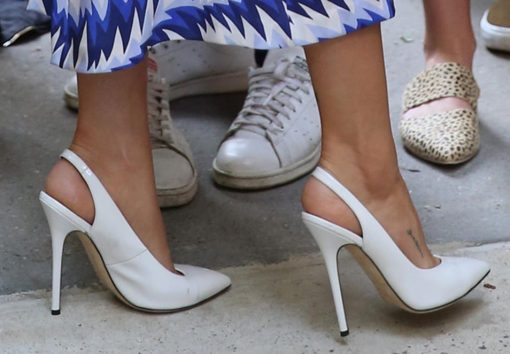 Selena Gomez wearing white leather slingback heels, selena gomez foot tattoo