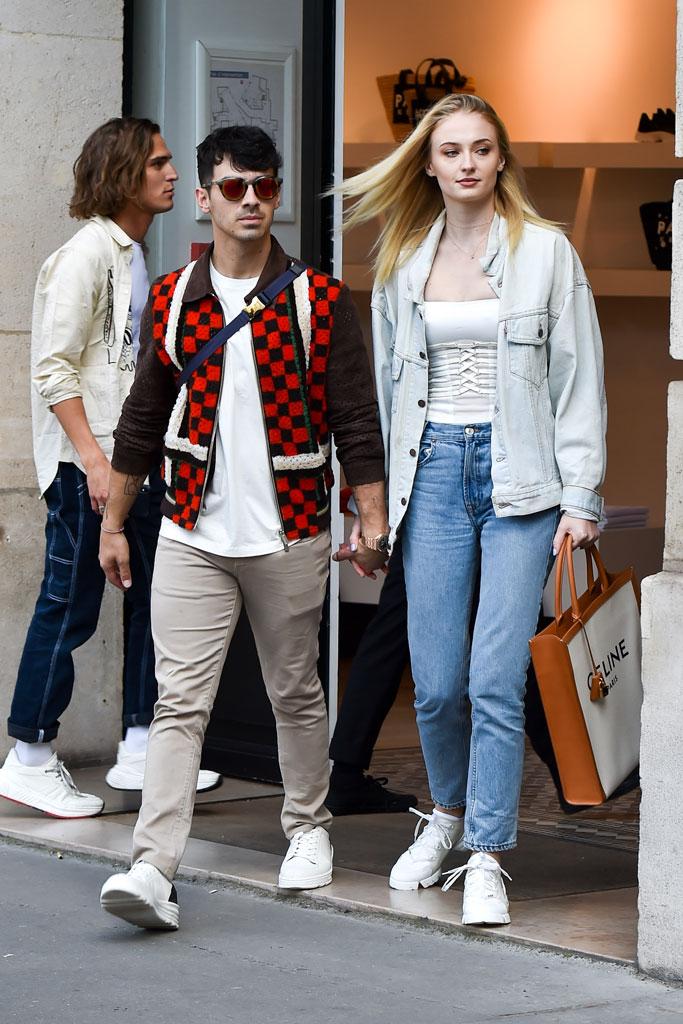 Sophie Turner, corset top, double denim, mom jeans, white sneakers, paris, kenzo store, joe jonas, celebrity style, couple, husband wife