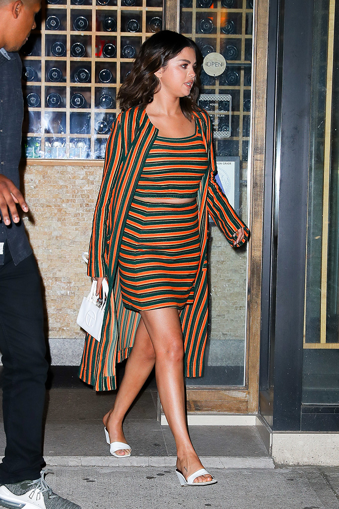 Selena Gomez wears a green and orange striped outfit while out and about in New York City, Selena was spotted leaving Sushi Seki Chelsea restaurant after having dinner with palsPictured: Selena GomezRef: SPL5097348 110619 NON-EXCLUSIVEPicture by: Felipe Ramales / SplashNews.comSplash News and PicturesLos Angeles: 310-821-2666New York: 212-619-2666London: 0207 644 7656Milan: 02 4399 8577photodesk@splashnews.comWorld Rights