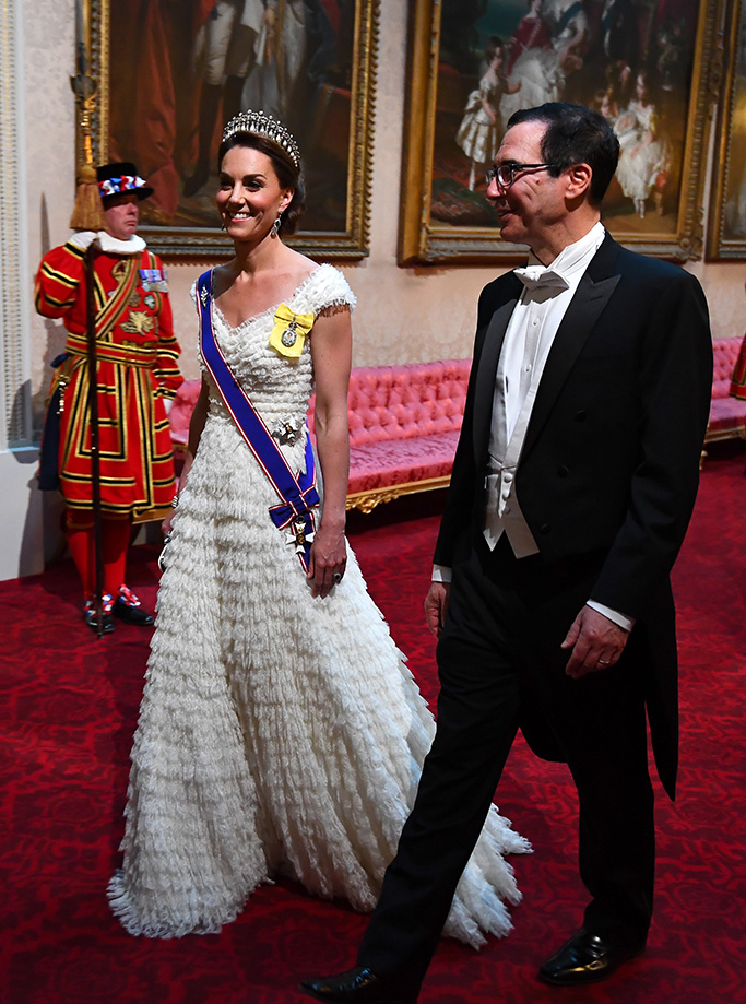 Catherine Duchess of Cambridge and United States Secretary of the Treasury, Steven Mnuchin arrive through the East Gallery during the State Banquet at Buckingham Palace, London, on day one of the US President's three day state visit to the UKUS President Donald Trump state visit to London, UK - 03 Jun 2019