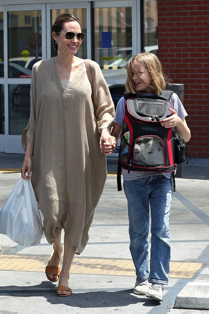Angelina Jolie, vivienne jolie-pitt, celebrity style, knit sweater dress, monochrome trend, slides, pet store, rabbit