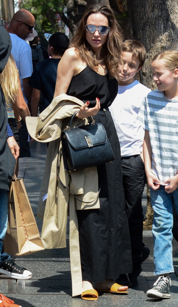 Angelina Jolie, salvatore ferragamo bag, black tank top, everlane trench coat, slide sandals,vivienne Jolie-Pitt, Vivienne Jolie-PittAngelina Jolie out and about, Los Angeles, USA - 06 Jul 2019