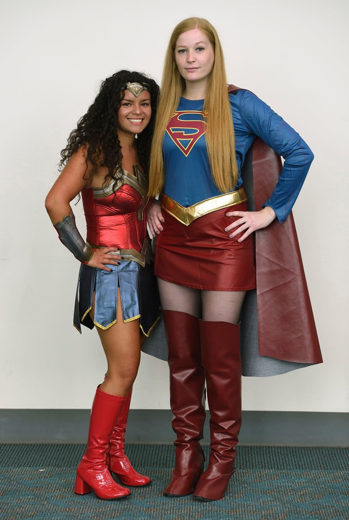 super girl, Wonder Woman, knee-high boots, thigh-high boots, Kaytlin Ortiz, Caileigh Travers. Kaytlin Ortiz, left, dressed as Wonder Woman, and Caileigh Travers, dressed as Supergirl, of New York, attend day two of Comic-Con International, in San Diego2019 Comic-Con, San Diego, USA - 19 Jul 2019