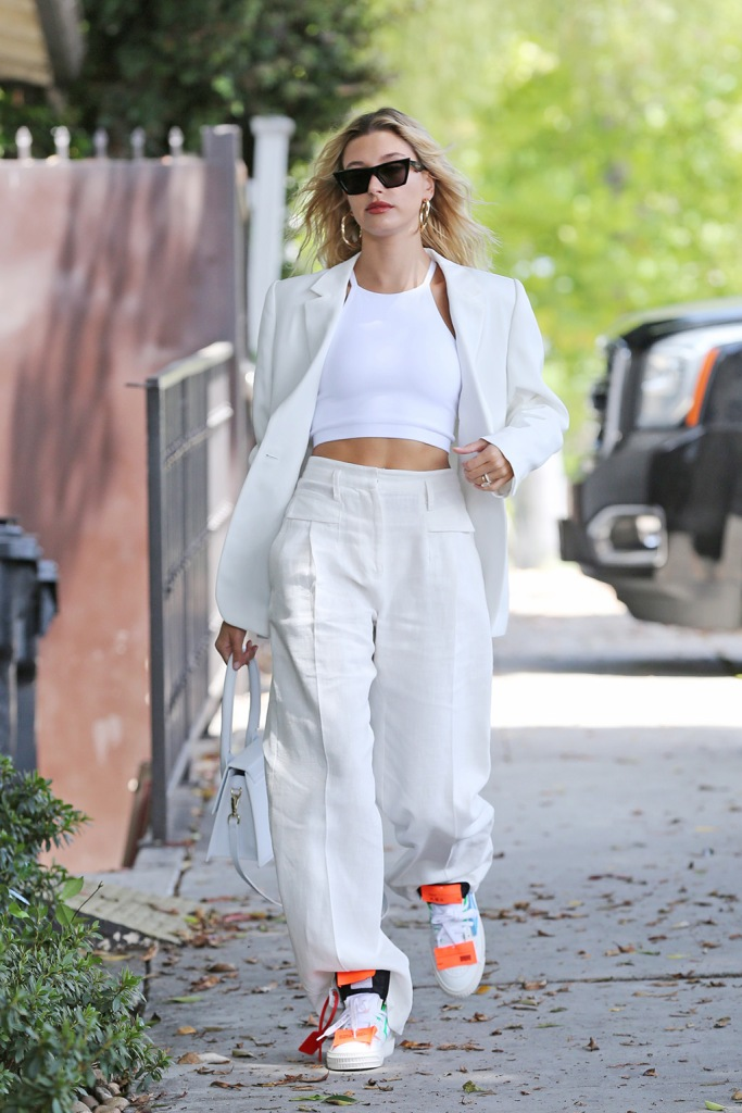 Stylish model Hailey Baldwin shows offer toned midriff in a white suit during an outing in West Hollywood. 28 Jul 2019 Pictured: Hailey Baldwin Bieber. Photo credit: Rachpoot/MEGA TheMegaAgency.com +1 888 505 6342 (Mega Agency TagID: MEGA474828_011.jpg) [Photo via Mega Agency], Off-White Off-Court sneakers