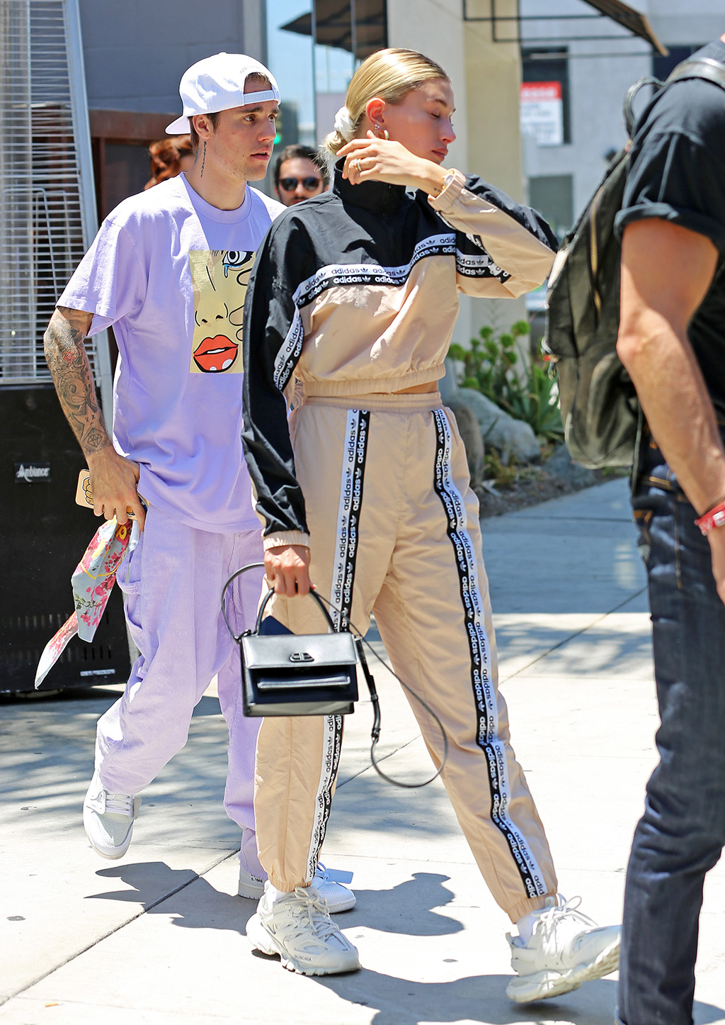 Hailey Baldwin, Adidas tracksuit, Balenciaga track sneakers, Balenciaga purse, Jennifer fisher earrings, scrunchie, celebrity style, Justin Bieber and Hailey Baldwin step out in eye-catching outfits while accompanied by members of their church in Los Angeles, CA.Pictured: JUSTIN BIEBER AND HAILEY BALDWINRef: SPL5104954 200719 NON-EXCLUSIVEPicture by: SplashNews.comSplash News and PicturesLos Angeles: 310-821-2666New York: 212-619-2666London: 0207 644 7656Milan: 02 4399 8577photodesk@splashnews.comWorld Rights, No Brazil Rights