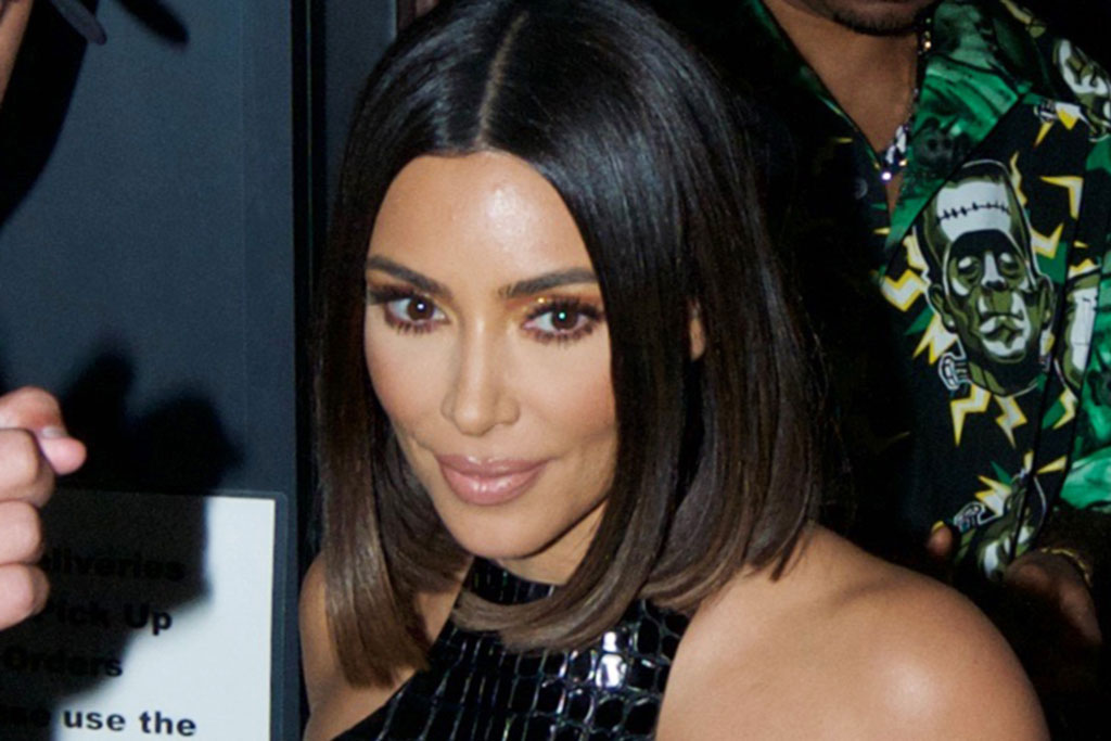 Does Kim Kardashian Have Six Toes? Her Feet in Sandals Go Viral in Ad –  Footwear News