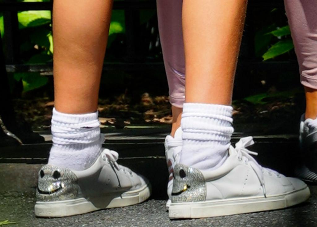 J-Lo's daughter Emme wearing Lola Cruz Smlie sneakers