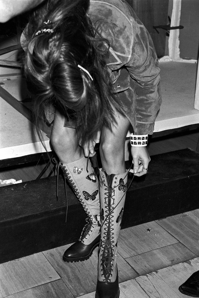Unidentified model lacing up boots backstage at the Perry Ellis Spring/Summer 1993 show in New York designer by Marc Jacobs