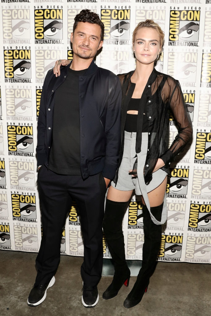 Orlando Bloom and Cara Delevingne, 2019 comic-con, Christian Louboutin's black Kiss Me Gina over-the-knee boots