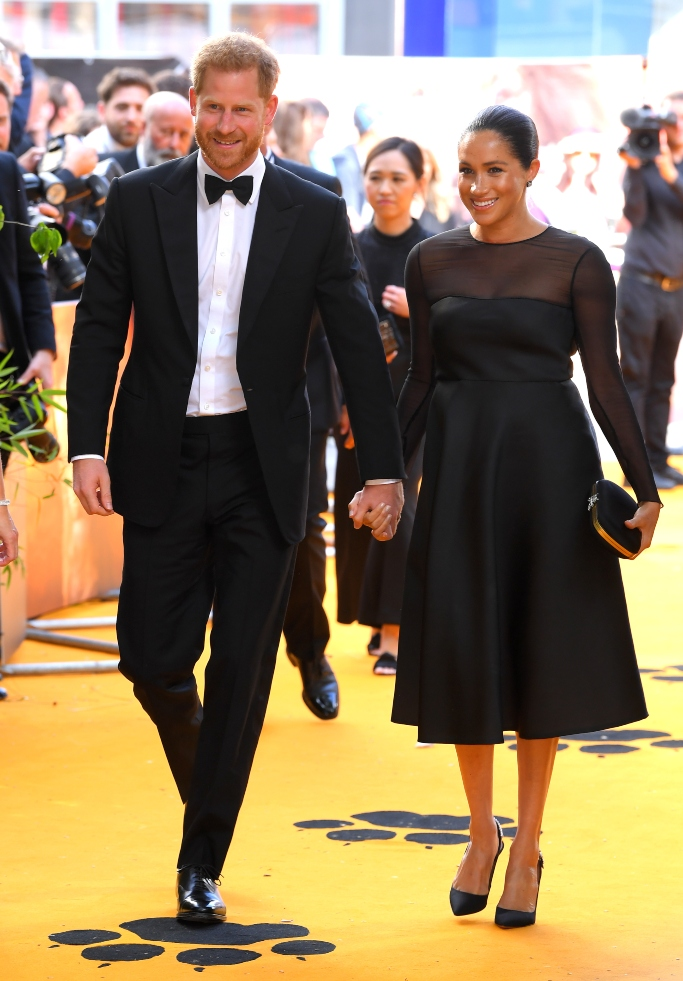 meghan markle and prince harry attend the lion king london premiere