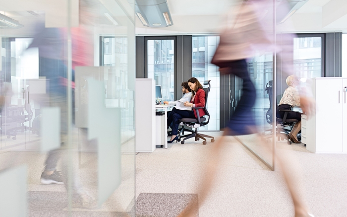 Businesspeople work in an office