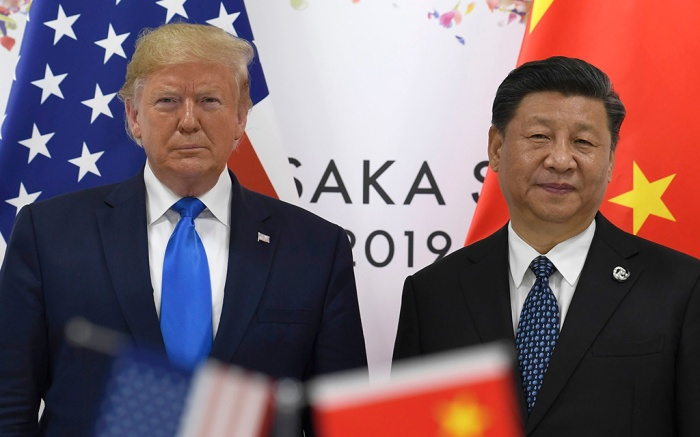 Donald Trump, Xi Jinping. President Donald Trump, left, poses for a photo with Chinese President Xi Jinping during a meeting on the sidelines of the G-20 summit in Osaka, JapanTrump G20 US China, Osaka, Japan - 29 Jun 2019