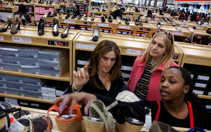 Retail sales Sales associate Michelle Webb, right, helps Maya Mamane, left, and Nili Melamed pick out shoes at Century 21 department store, in New York. Many retailers are reporting solid sales gains for February, even in the face of falling consumer confidence and heavy snowstorms that hammered the East CoastRetail Sales, New York, USA