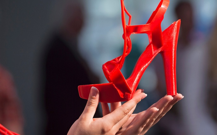 A woman presents the 3D printed shoe 'Liberte' desgigned by Danit Peleg of Israel during the international fairs FabCon 3.D and Rapid.Tech at Messe Erfurt in Erfurt, Germany, . Exhibitors from all over the world present the latest products and applications in the fields of additive manufacturing and 3D printing until June 16, 2016Germany 3D Printing Fair, Erfurt, Germany