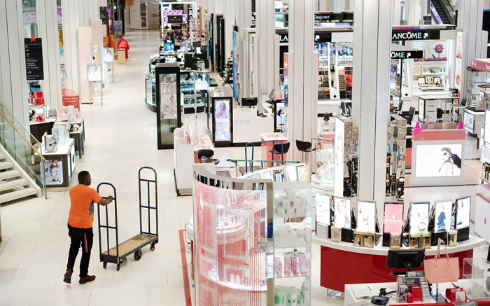 A man pushes a stock cart through Macy's before the store opens to customers, in New YorkMacy's, New York, USA - 10 Apr 2019