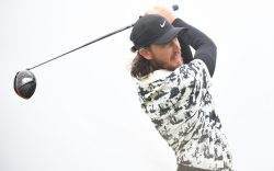 Tommy Fleetwood of England tees off