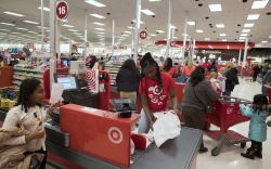 Customers check out at a Target