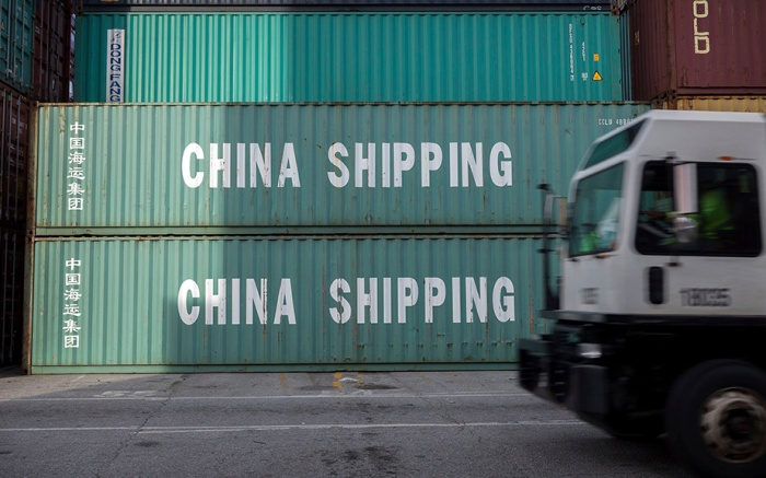 In this July, 5, 2018 photo, a jockey truck passes a stack of 40-foot China Shipping containers, at the Port of Savannah in Savannah, Ga. The U.S. hiked tariffs on Chinese imports Friday and Beijing said it immediately retaliated in a dispute between the world's two biggest economiesChina Tarriffs, Savannah, USA - 05 Jul 2018