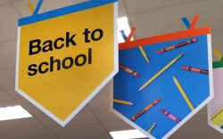 """Back to school"""" signage hangs in"""