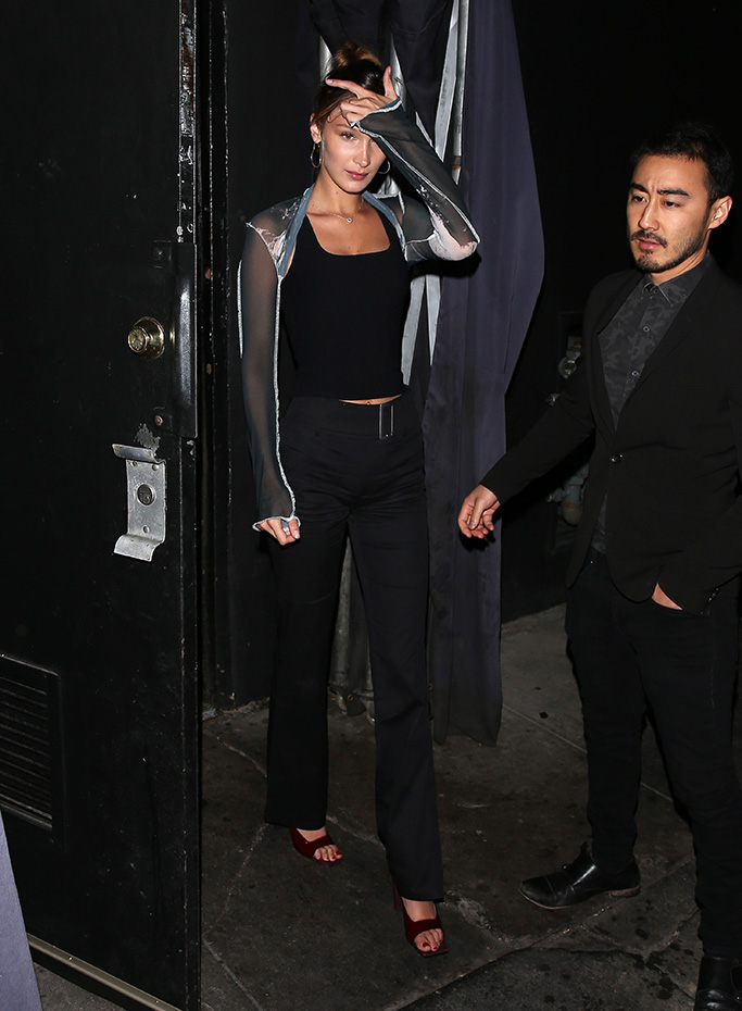 Bella Hadid, red heels, west hollywood, the nice guy, i.am.gia colton pants