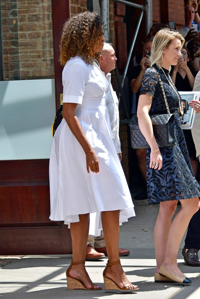 Michelle Obama, white dress, Gianvito Rossi wedge sandals, celebrity shoe style, waves to the crowd after a lunch benefit with Sarah Jessica Parker among others at the Greenwich Hotel in New York CityPictured: Michelle ObamaRef: SPL5105974 250719 NON-EXCLUSIVEPicture by: Edward Opi / SplashNews.comSplash News and PicturesLos Angeles: 310-821-2666New York: 212-619-2666London: 0207 644 7656Milan: 02 4399 8577photodesk@splashnews.comWorld Rights