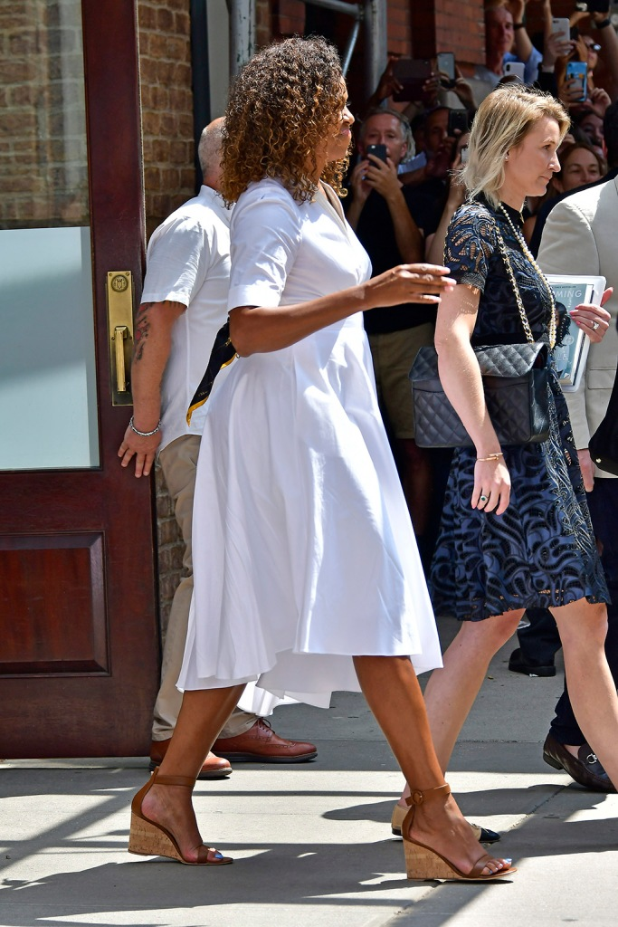 Michelle Obama waves to the crowd after a lunch benefit with Sarah Jessica Parker among others at the Greenwich Hotel in New York CityPictured: Michelle ObamaRef: SPL5105974 250719 NON-EXCLUSIVEPicture by: Edward Opi / SplashNews.comSplash News and PicturesLos Angeles: 310-821-2666New York: 212-619-2666London: 0207 644 7656Milan: 02 4399 8577photodesk@splashnews.comWorld Rights