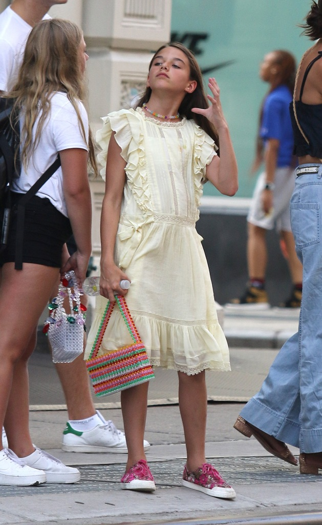 sure cruise, tretorn sneakers, yellow minidress, celebrity style, Katie Holmes and daughter Suri braved the brutal heatwave while shopping and hailing a taxi. Katie showed off her midriff as she was spotted shopping for earrings and other things in Chinatown, while later Suri and Katie both hailed for a cab in Manhattan's Downtown area. 20 Jul 2019 Pictured: Suri Cruise. Photo credit: LRNYC / MEGA TheMegaAgency.com +1 888 505 6342 (Mega Agency TagID: MEGA470034_017.jpg) [Photo via Mega Agency]