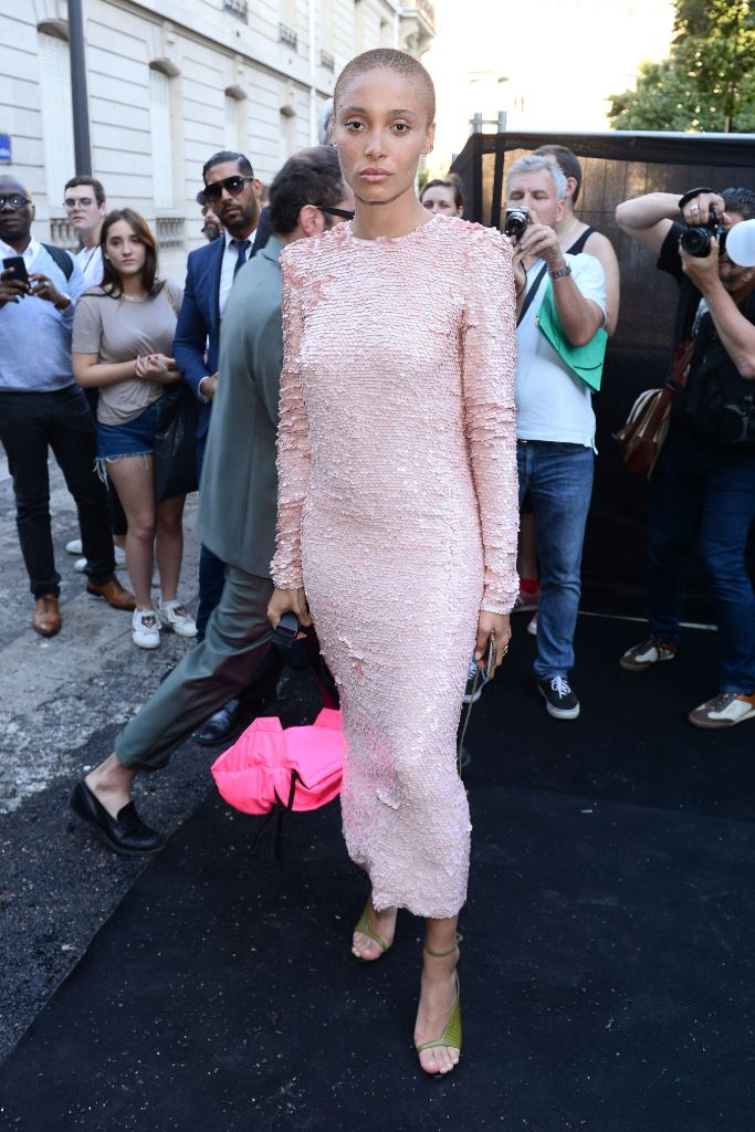 Adwoa Aboah wearing a pale pink sequined Givenchy dress with a hot pink Prada bag and green sandals