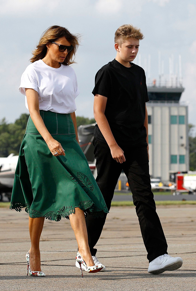 nike sneakers, shoes, christian louboutin heels, Donald Trump, Melania Trump. First lady Melania Trump walks with son Barron Trump to Air Force One at Morristown Municipal Airport in Morristown, N.J., en route to Andrews Air Force Base, MdTrump, Morristown, USA - 18 Aug 2019