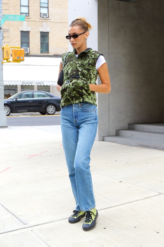 Bella Hadid wears a camouflage vest with jeans while apartment hunting in SoHo in NYCPictured: Bella HadidRef: SPL5111338 270819 NON-EXCLUSIVEPicture by: Felipe Ramales / SplashNews.comSplash News and PicturesLos Angeles: 310-821-2666New York: 212-619-2666London: 0207 644 7656Milan: +39 02 56567623photodesk@splashnews.comWorld Rights