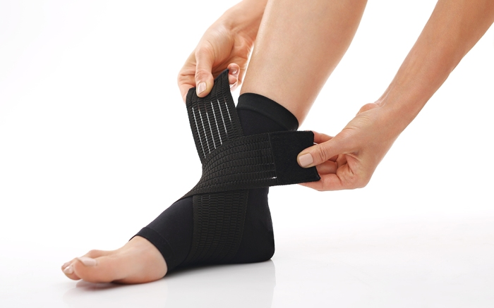 Compression stabilizer ankle. Foot injury, compression bandage; Shutterstock ID 305350484; Usage (Print, Web, Both): Web; Issue Date: 8/14