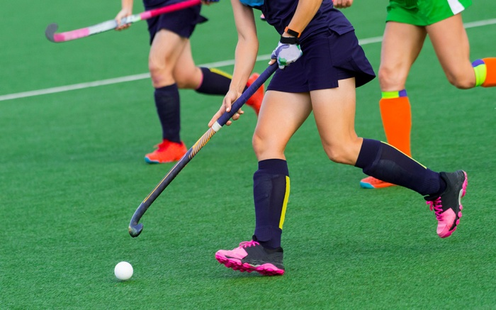three women battle for control of ball during field hockey game; Shutterstock ID 1162170802; Usage (Print, Web, Both): Web; Issue Date: 8/27