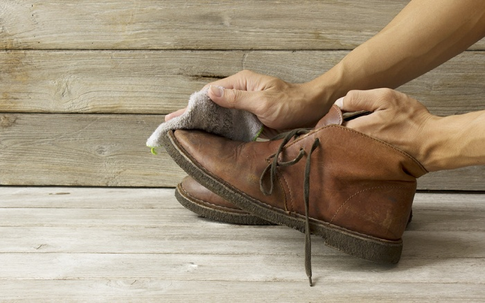 Cleaning shoes; Shutterstock ID 302174036; Usage (Print, Web, Both): Web; Issue Date: 8/15
