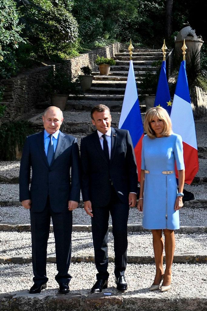 Vladimir Putin, Emmanuel Macron and Brigitte Macron