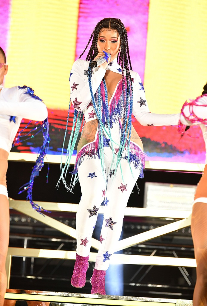 Cardi B, pink glittery saint laurent boots, star-print jumpsuit, braids, Real Street Festival, Anaheim, USA - 11 Aug 2019